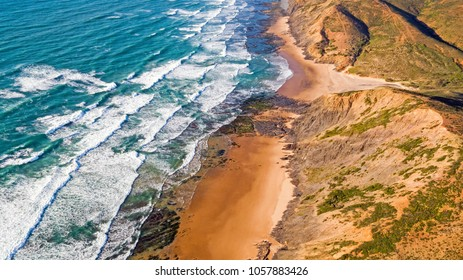Aerial from ocean waves hitting the shore from the westcoast in Portugal