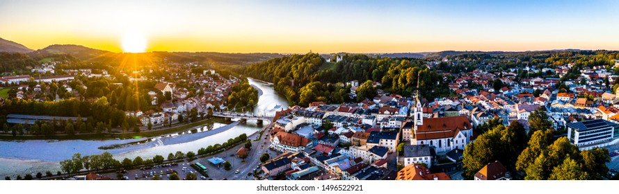 Aerial of old bavarian town Bad Toelz in Bavaria. ISar River is running through the CIty. Alps Mountains in the back. Sunset