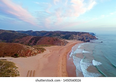 Aerial on Praia Amado on the west coast in Portugal at sunset