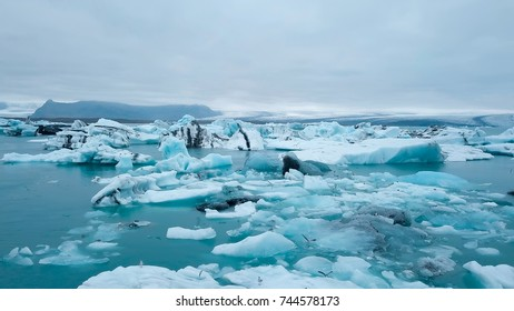Aerial over icebergs floating in Jokulsarlon Lagoon by the southern coast of Iceland