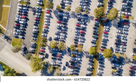 Aerial overhead view of big and crowded car parking.