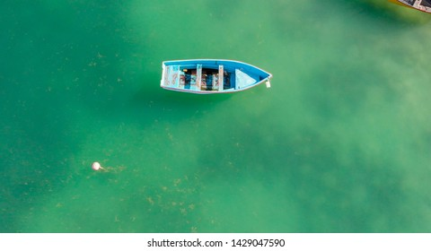 Aerial overhead view of wooden boat in the ocean. Relax and holiday concept.