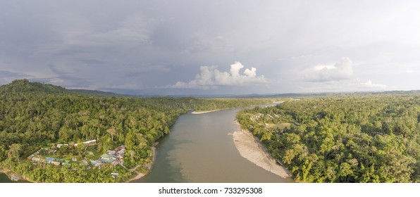 Aerial overlooking Rio Napo  above Misahualli village, a popular destination for adventure tourism in the Ecuadorian Amazon. The clear water Rio Misahualli mixes with the sediment loaded Rio Napo.