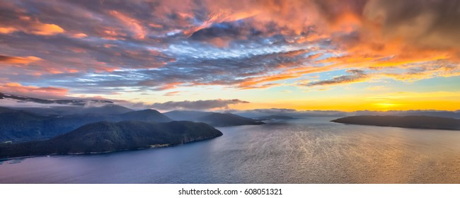 Aerial overview of Norwegian fjords at sunset in midfjord near Molde Norway