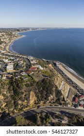 Aerial of Pacific Palisades neighborhoods and Pacific Coast Highway in Los Angeles California.