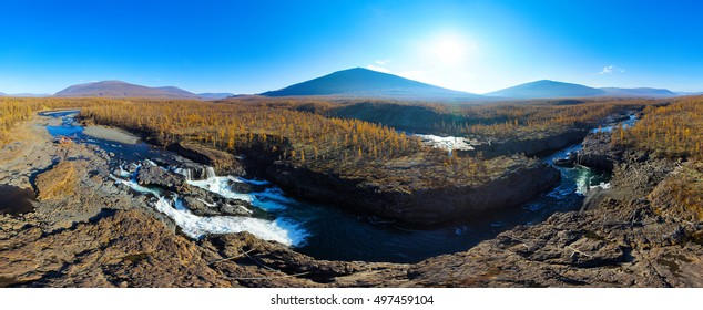 Aerial panorama of the autumn mountains landscape. Waterfall in the National park Putorana in Siberia. Nature and ecology concept.
