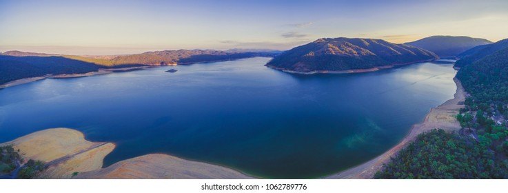 Aerial panorama of a beautiful lake in mountains at sunset