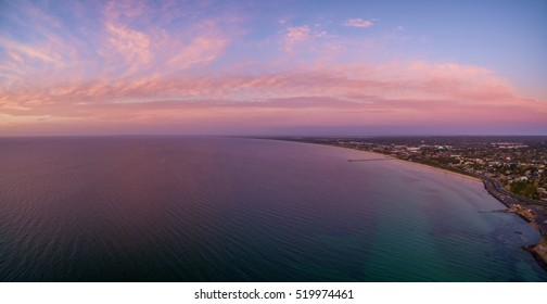 Aerial panorama of beautiful sunset over Mornington Peninsula coastline near Frankston suburb. Melbourne, Australia.