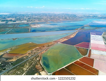 Aerial panorama birds eye view highways and Nature Reserve of Santa Pola Salt Lakes. Drone photo salt production marshy area view from above. Torrevieja. Costa Blanca. Province of Alicante. Spain