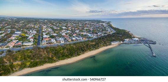 Aerial panorama of Black Rock suburban area,  coastline, pier and wharf at sunset. Melbourne, Victoria, Australia