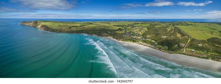 Aerial panorama of Cape Bridgewater beach, settlement, and wind farm in Victoria, Australia