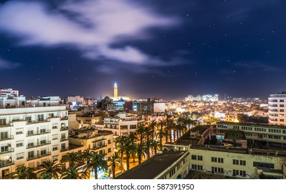 Aerial Panorama of Casablanca in Morocco at night. Illuminated Hassan II Mosque in the background