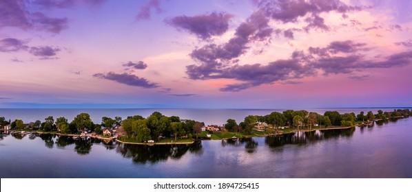 Aerial panorama of the Cedar Point peninsula at dusk, in Sandusky, Ohio, on the Erie lake.