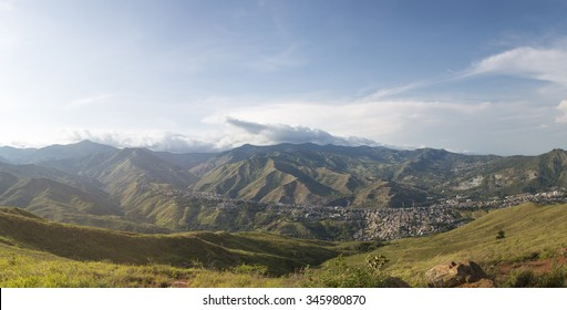 Aerial panorama of the city of Cali taken from the top of Cristo del Rey against a blue sky. Colombia 2015