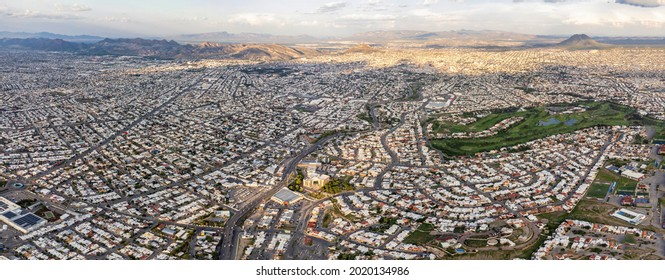 Aerial panorama of the city of Chihuahua, Mexico at sunset, seen from its west side.