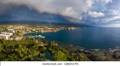 Aerial panorama of the city of Kailua Kona with rainbow in the sky. Big Island, Hawaii