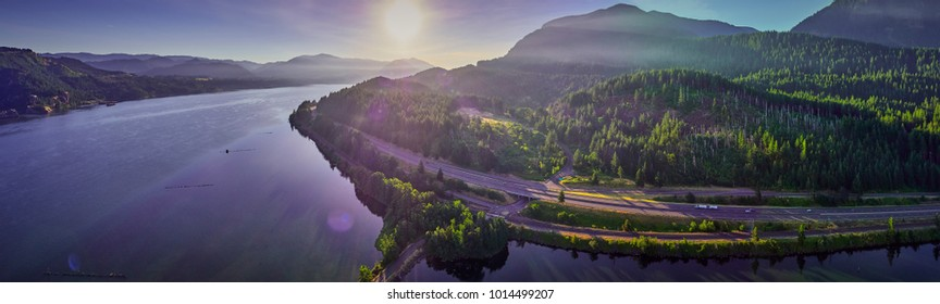 Aerial Panorama of the Columbia River and surrounding forest and hills rising up from the river the morning in the Columbia River Gorge