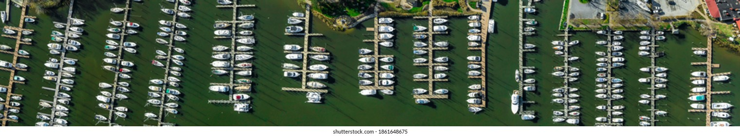 Aerial panorama of Deale  waterfront docks on the Western Shore of Chesapeake Bay Maryland, with rows of of luxury sailboats docking in the marina.