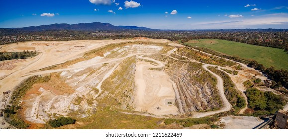 Aerial panorama of decommissioned mine pit and mountains