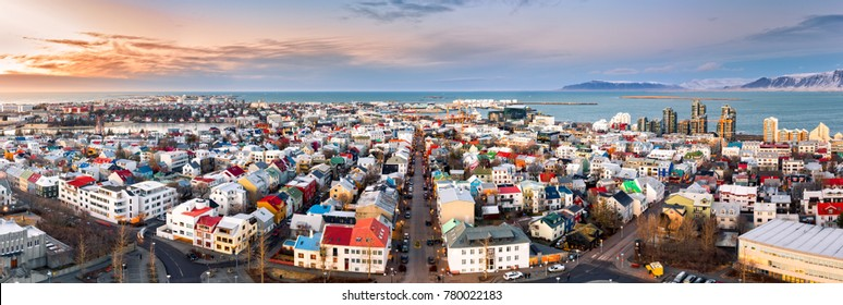 Aerial panorama of downtown Reykjavik at sunset with colorful houses and commercial streets