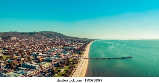 Aerial panorama of Dromana suburb and long wooden pier in Melbourne, Australia