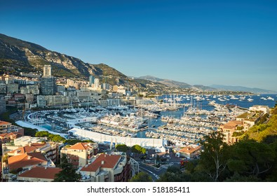 Aerial Panorama of first day MYS Monaco Yacht Show, Port Hercules, luxury megayachts, big boat, view from Princes Palace of Monaco, sunset