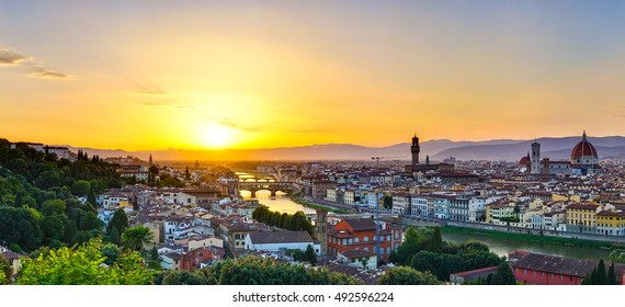 Aerial panorama of Florence city, Arno River and Ponte Vecchio at sunset. Florence city in Italy, Europe