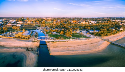 Aerial panorama of Frankston waterfront at sunset. Frankston yacht club and footbridge over Kananook creek.