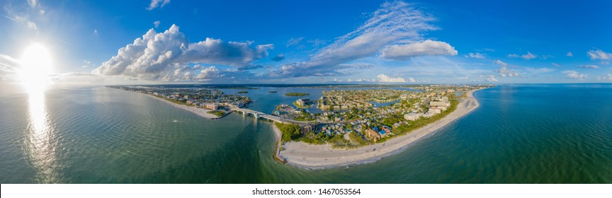 Aerial Panorama of John's Pass Village and Boardwalk during sunset in Madeira Beach,Pinellas County,Florida.