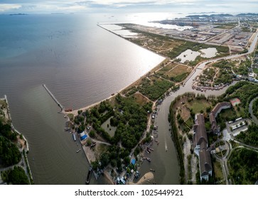 Aerial panorama of Laem Chabang Port construction site, Chonburi Province, an important logistic site of Thailand. The local fishermen village is just right next to the industrial port.