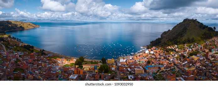 Aerial panorama of the lake of Titicaca and the town of Copacobana during the sunny calm day, Bolivia