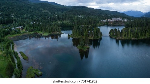 Aerial panorama landscape of Alpha Lake in Whistler City, British Columbia, Canada, during a cloudy morning sunrise.