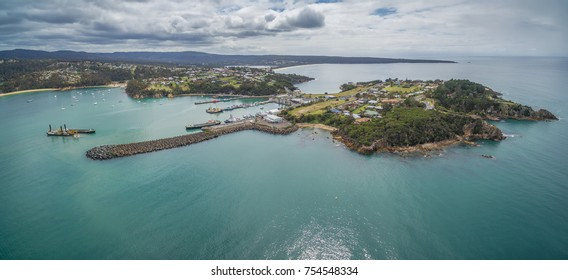 Aerial panorama of the lookout point where people watch for whales and wharf in Eden, NSW, Australia
