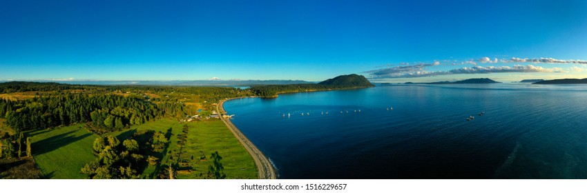 Aerial Panorama of Lummi Island, Washington. Located in the Puget Sound, Lummi Island is surrounded by the Salish Sea and is home to the famous Willows Inn and the last remaining reefnet salmon fleet.
