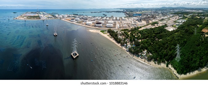 Aerial Panorama of Map Ta Phut industrial area, including coal power plant, ports and petrochemical plants in Eastern Economic Corridor, Rayong, Thailand.  Note that the sea was severely polluted.
