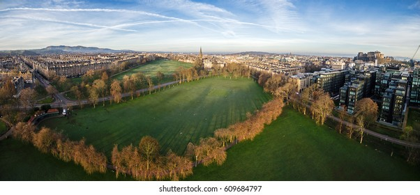 Aerial panorama of The Meadows Park with the Edinburgh Castle (top right). Edinburgh, Scotland, UK