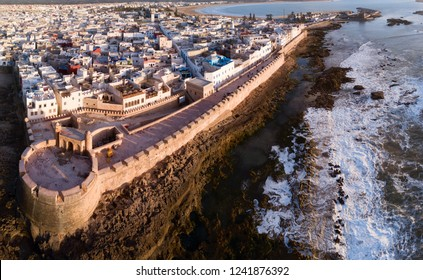 Aerial panorama of medieval Essaouira old city on Atlantic coast at sunset, Morocco
