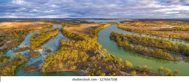 Aerial panorama of Murray River and Wachtels Lagoon among islands of gum trees at sunset. Riverland, South Australia