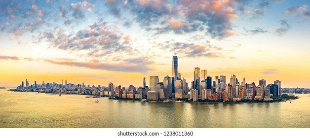 Aerial panorama of New York City skyline at sunset with both midtown and downtown Manhattan