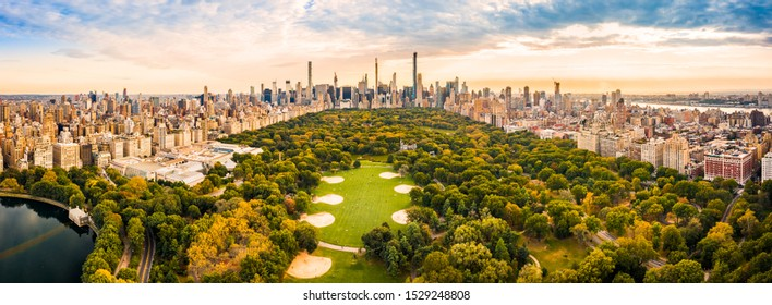 Aerial panorama of New York midtown skyline at sunset viewed from above Central Park.