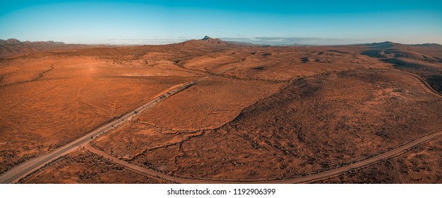Aerial panorama of orange unreal alien landscape. Flinders Ranges, South Australia