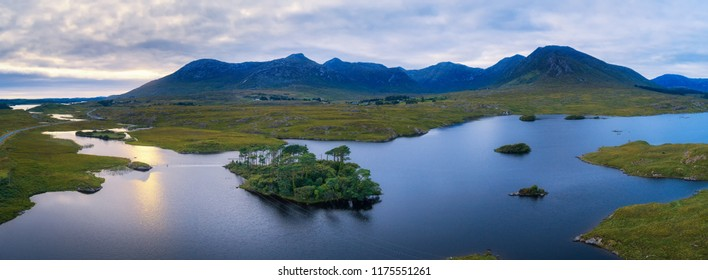 Aerial panorama of the Pine Trees Island in the Derryclare Lake, Galway county, Ireland