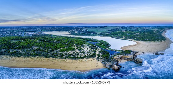 Aerial panorama of Point Ritchie lookout and Hopkins River mouth at dusk. Warrnambool, Australia