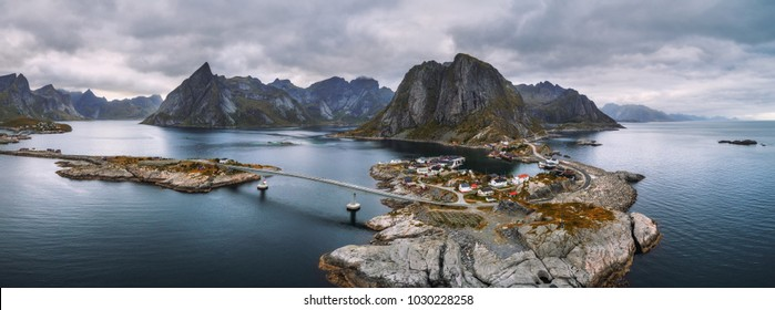 Aerial panorama of Reine and Hamnoy fishing villages with fjords and mountains in the background. These villages are located on several small islands in the Lofoten archipelago in Norway