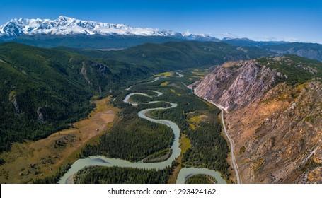 Aerial panorama of the river of Chuya, mountains Northern Chuysky Range and road Chuysky Trakt. Altai, Russia