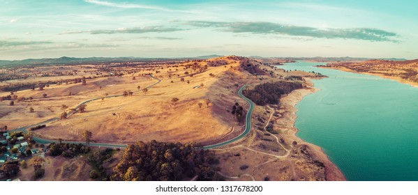 Aerial panorama of Riverina Highway passing near Lake Hume and Murray River at sunset. New South Wales, Australia