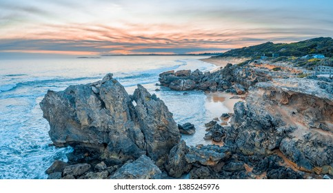 Aerial panorama of rocks at Point Ritchie lookout at dusk. Warrnambool, Victoria, Australia