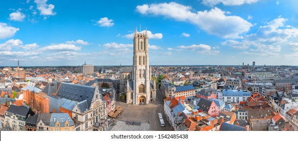 Aerial panorama of Saint Bavo cathedral and Gent cityscape from the Belfry of Ghent on a sunny day. Beautiful architecture and landmark of the medieval city of Gent in Belgium on summer.