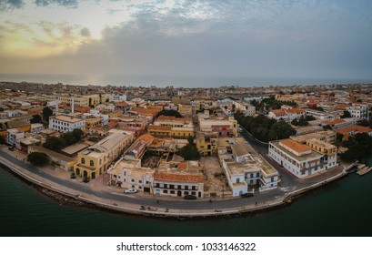 Aerial panorama of Sant Louis, a unesco heritage city in northern Senegal. View from Senegal river towards the old colonial city and fisherman island.
