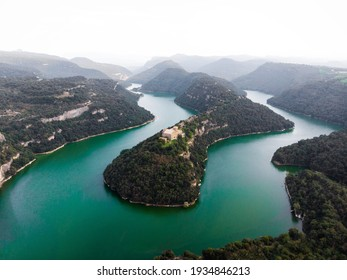 Aerial panorama of Sant Pere de Casserres cloister monastery isolated church on hill at Ter river bend Les Masies de Roda Osona Catalonia Spain Europe